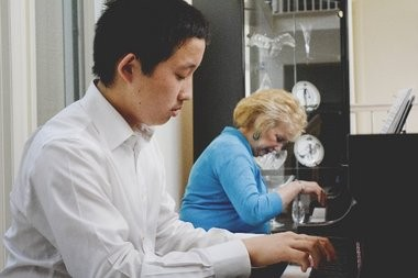 Ingrid Clarfield's passion for music and teaching, and decades worth of piano mastery have drawn the interest of plenty of musicians, who eagerly wait to audition for her. Here, she works with student Charlie Liu, 13, of Princeton.