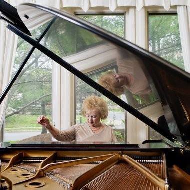 """""""(She) reinvented herself. ... she figured out a way to continue doing what she loves to do,"""" says Lu Leslan, a Seattle piano teacher who produced and directed a 2011 documentary """"Take a Bow: The Ingrid Clarfield Story."""""""