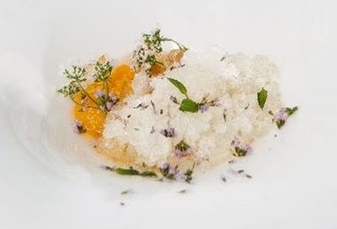 A tomato water granita features blossoms and mint.