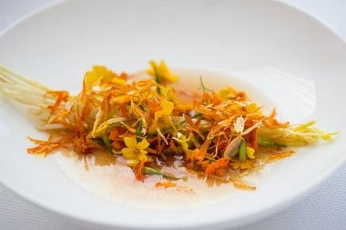Wild asparagus, at far right, is sliced like matchsticks and paired with a walnut oil consomme and a scattering of marigolds.