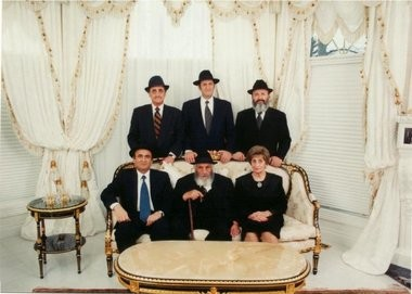 The Ghermezian family, circa 1999, at their Edmonton residence: seated left to right, son Eskandar, patriarch Jacob and mother Myriam, and standing, from left, sons Nader, Raphael and Bahman.