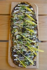 Huarache de hongos, a flatbread filled with forest mushrooms, covered with huitlacoche sauce, black truffle and corn shoots.