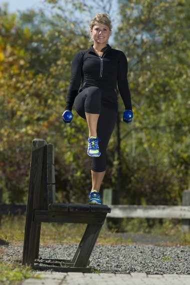 Marie Luisi, a health fitness specialist, demonstrates one of her favorite exercises — step-ups — at the Great Swamp National Wildlife Refuge in Morris County.