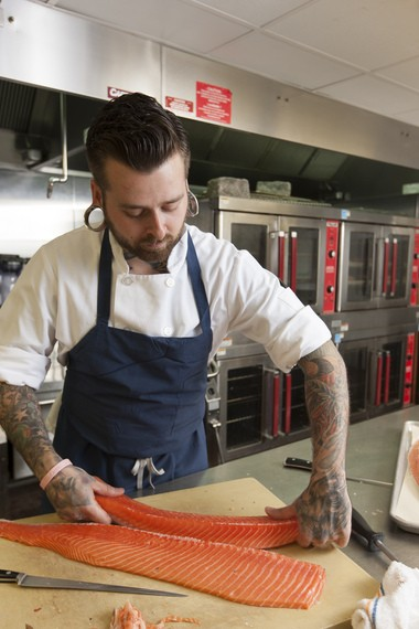 Sous chef Joe Beninato prepares salmon in Ursino's kitchen.