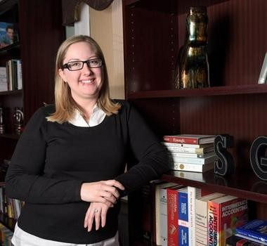 Alison Williams, who lives with her boyfriend in a Jersey City apartment, says both incomes are essential to make ends meet and saving money can be difficult. (Danielle Richards | For NJ Advance Media)