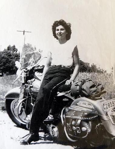 Gloria Struck and her motorcycle in 1951.