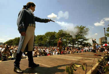 Antonio Burr, left, a descendant of Aaron Burr's cousin, fires with Douglas Hamilton, right, a fifth-great-grandson of Alexander Hamilton, during a reenactment marking the 200th anniversary of the Alexander Hamilton-Aaron Burr duel on July 11, 2004 in Weehawken.