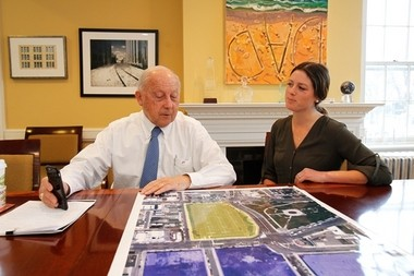 Jon Hanson confers with granddaughter Jenna Imperatore at the Morristown headquarters of his real estate business, Hampshire Companies.