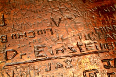 The tabletop — into which Albert Einstein is said to have carved his name — at the Yankee Doodle Tap Room.