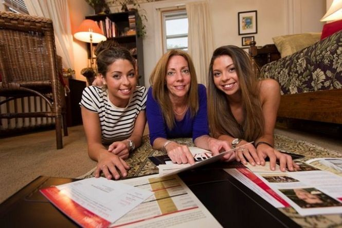 Nancy Duke, center, of Scotch Plains, goes over a stack of college finance materials with twins Alexandra, left, and Elisabeth as they head to Rutgers, where the expected annual cost is nearly $30,000 -- for each daughter. (Steve Hockstein)