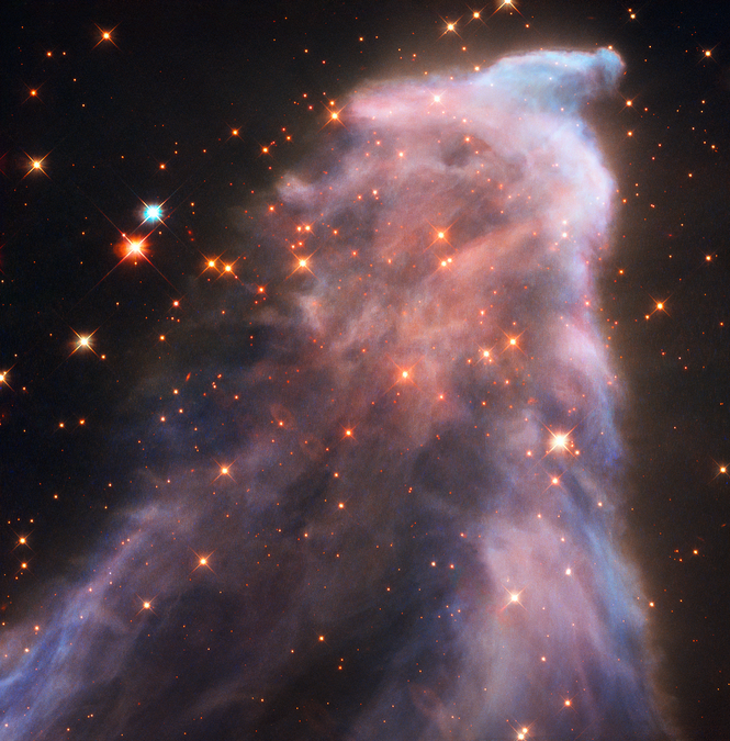 "Hubble Captures the Ghost of Cassiopeia (August 2016). Powerful gushers of energy from seething stars can sculpt eerie-looking figures with long, flowing veils of gas and dust. One striking example is ""the Ghost of Cassiopeia,"" officially known as IC 63, located 550 light-years away in the constellation Cassiopeia the Queen. The nebula's ethereal glow might remind people of apparitions such as those reported by paranormal investigators. In reality, it's simply hydrogen that is being bombarded with ultraviolet radiation from the nearby, blue-giant star Gamma Cassiopeiae, causing it to glow in red light. The blue color is from light reflected off of the nebula's dust."