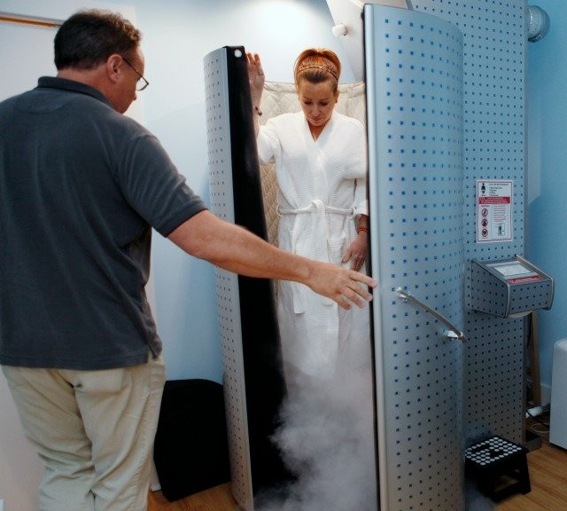Aesthetician Carin Frisco steps out of the cryosauna chamber at 256 Below in Millburn, after company owner Stan Kapica opens the tank.