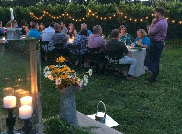 Visitors to Grace Winery enjoy dinner outdoors in the vineyards.