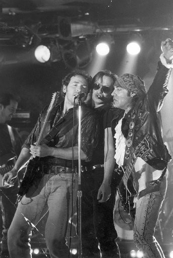 Bruce Springsteen, left, Southside Johnny, center, and Steven Van Zandt perform on The Stone Pony stage in September 1991.