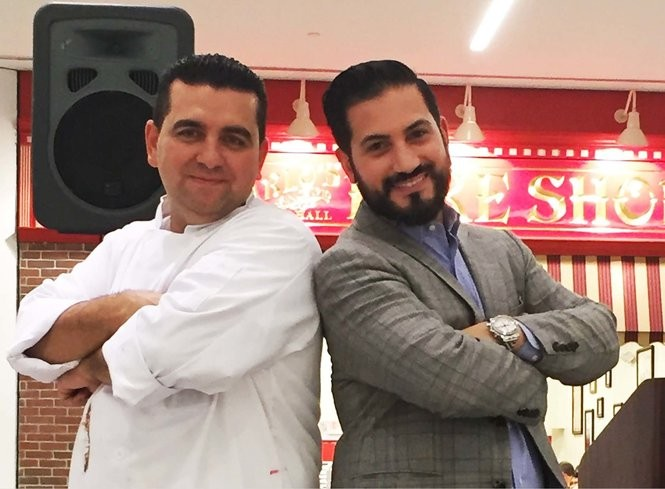 Leo Minervini, right, is a key leader in one the fastest growing companies, Carlo's Bakery. Alongside his childhood friend and boss, Buddy Valastro, they have created a booming business.