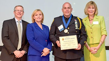 David Martel, vice president of marketing, NJ Advance Media, Kim Guadagno, lieutenant governor, New Jersey, Sgt. Michael Boll, honoree and Linda Bowden, president, PNC Bank New Jersey.