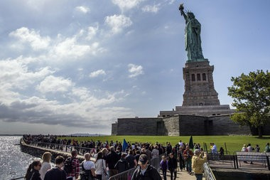 A boat carrying 121 tourists ran aground near the Statue of Liberty on Saturday afternoon, officials said.