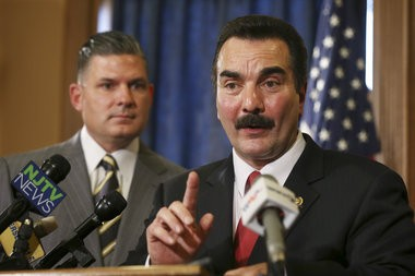 As New Jersey Assemblymen Louis D. Greenwald, D- Voorhees, looks on, Assembly Speaker Vincent Prieto, right, D-Secaucus, addresses a gathering Thursday, Nov. 5, 2015, in Trenton.