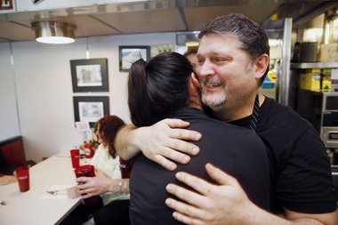 Nick Kallas hugs his wife, Maria, after the diner was named N.J.'s best (Alex Remnick I NJ Advance Media for NJ.com)