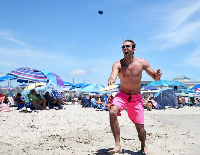 Darren Robbins, of Chicago, plays a game of paddle ball on the beach in Cape May, N.J., Monday, July 11, 2016. (Lori M. Nichols | For NJ.com)