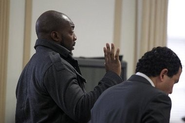 Former Jet Bryan Thomas during a court appearance in February. At right is his attorney, Joseph Tacopina.