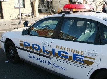 A Bayonne man has been charged with a DWI after he was found him sleep in his car in the middle of traffic, police said.