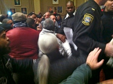 Citizens rush the stage at a Newark council meeting, November 20, 2012 after Mayor Cory Booker voted to appoint an ally to the city council. An appellate court upheld the ruling from December that Booker did not have the authority to vote.