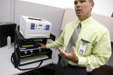 A State Police official demonstrates an Alcotest processing device to The Star-Ledger in this 2005 file photo.