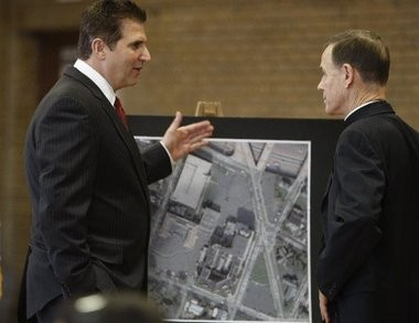 Essex County Executive Joe DiVincenzo, left, speaks to Rev. Edward Leahy, Essex County Vo Tech school board president, while looking at an aerial photograph of the United Hospital Medical Center in Newark in this February 2010 file photo.