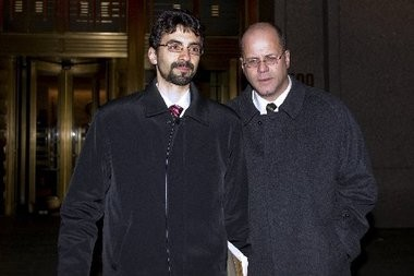 Sergey Aleynikov, a former Goldman Sachs Group Inc. computer programmer, left, and his lawyer Kevin Marino leave federal court in New York, U.S., on Thursday, Dec. 9, 2010.