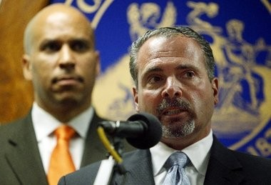 Newark Police Director Samuel DeMaio speaks in this 2011 file photo as Mayor Cory Booker looks on.