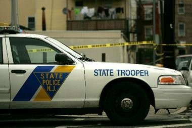 The New Jersey State Police agreed to pay $135,000 to a Mount Laurel man whom they arrested arrested in 2007 because of a disputed bill for $129.44 from an auto mechanic, his attorneys said Wednesday.