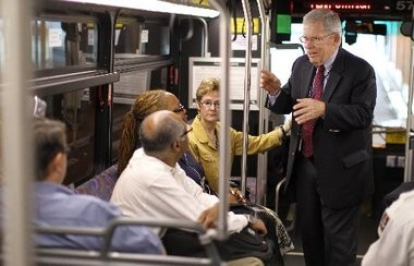 NJ Transit Executive Director Jim Weinstein chats with customers on a bus in Newark.