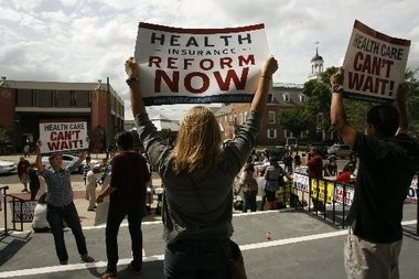 College officials are pushing lawmakers to kill the law because the implementation of Obamacare is driving up the cost of the basic health insurance plans offered to uninsured students by their schools. A health care reform rally at Rutgers University is shown in this file photo.
