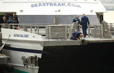 Investigators examine the damage on board the Seastreak Wall Street ferry. The NTSB today recounted the captain's efforts to transfer engine controls just before the crash