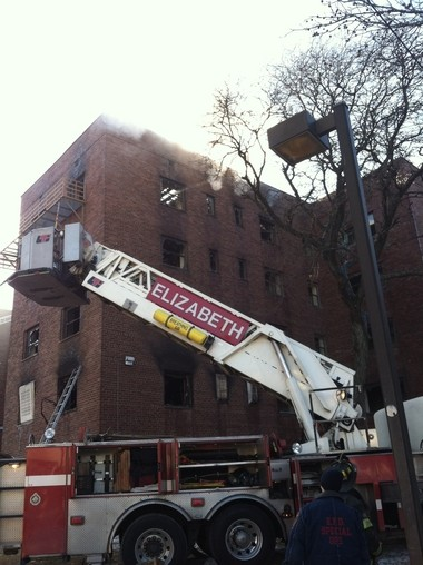 Firefighters were still extinguishing hot spots on the top floors of the building at 2 p.m.