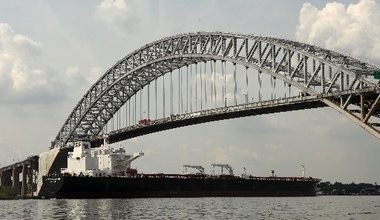 A proposal to raise the Bayonne Bridge has divided the EPA and the Coast Guard over whether the project would have a significant environmental impact.