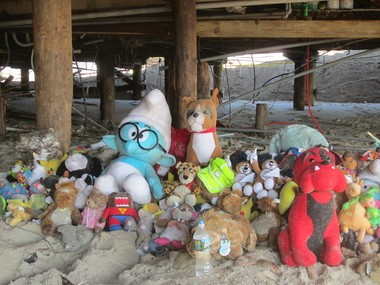 A makeshift shrine of rescued plush toys has been assembled under the boardwalk near Funtown Pier.