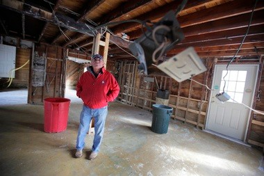 John Coyle surveys work yet to be done in the former Under the Mistletoe shop.