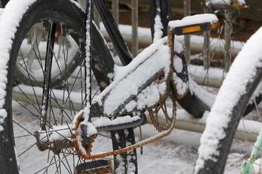 Bicycles await the thaw, and summer, behind Sink 'R Swim.