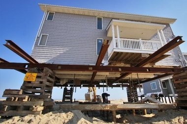 A home at the End of Dover Ave. on Ortley Beach that survived Hurricane Sandy but has been raised several feet to meet new building codes. Approved construction in New Jersey dipped by $200 million in November after Hurricane Sandy, but is expected now to recover as rebuilding begins.