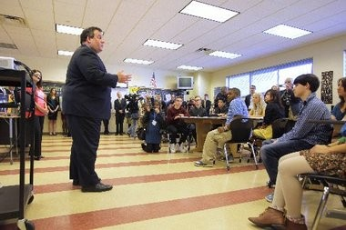 Gov. Chris Christie talks to a class at Bordentown Regional High School in 2012. Christie released his 2014 budget, including nearly $9 billion in education funding, this week. District-by-district state aid figures were released today.
