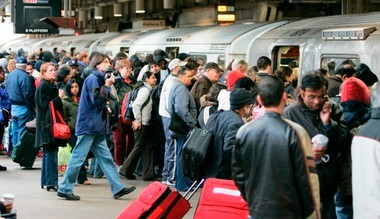 The U.S. Census Bureau has released new statistics on commuting trends. Pictured is a large crowd of commuters rushing to get aboard a PATH train in Newark in November 2007.