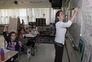 An elementary school teacher in Alexandria instructs her class. The district helped state education officials pilot a teacher evaluation system that will be rolled out statewide this fall.