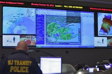 An NJ Transit police officer monitors Hurricane Sandy in the support room of the State Police Regional Operations Intelligence Center in Ewing.