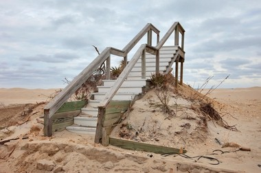 Stairs still sit atop a dune in Normandy Beach last month.