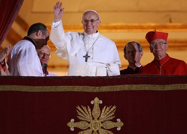 Newly elected Pope Francis I waves to the waiting crowd from the central balcony of St. Peter's Basilica on March 13, 2013 in Vatican City.