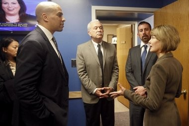 During her visit Sen. Barbara Buono, right, talks to Cory Booker, left, and John D. Perez, founder of the law firm Perez, Perez & Perez, P.C., and his son and colleague John J. Perez .