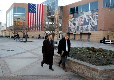 Kean President Dawood Farahi, left, walking across campus of Kean University, following a year of turmoil over accreditation issues, the probation of the school's sports teams, and a resume scandal.