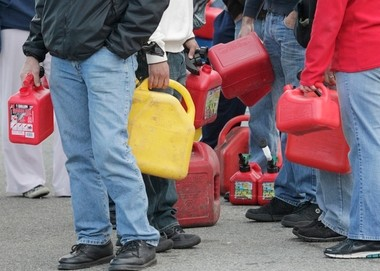 Eight business, including four hotels, three gas stations and a hardware store, reached settlements over allegations they excessively raised prices in the aftermath of Hurricane Sandy. Here, residents wait in gas lines after the storm.